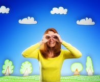 Happy smiling young woman on cartoon background Royalty Free Stock Photography