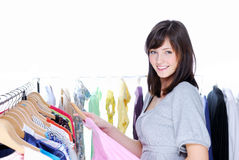 Happy smiling young woman choosing clothing Stock Photos
