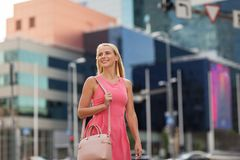 Happy smiling young woman on city street Royalty Free Stock Image