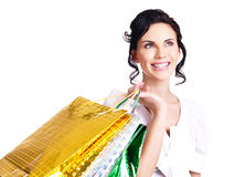 Happy smiling young woman with color bags. Royalty Free Stock Image