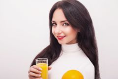 Happy smiling young woman drinking orange juice royalty free stock photos