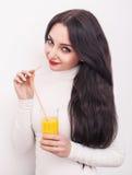 Happy smiling young woman drinking orange juice Stock Image