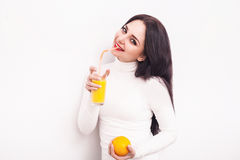 Happy smiling young woman drinking orange juice Royalty Free Stock Images