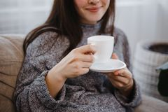 Happy smiling young woman enjoy morning coffee royalty free stock photography