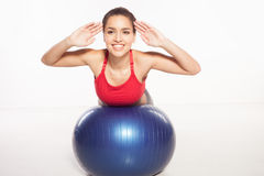 Woman exercising her abs on a pilates ball Stock Photography