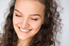 Happy smiling young woman face with closed eyes.Close-up portrait. Smile happy woman young curls Stock Image