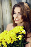 Happy smiling young woman with flower bouquet Royalty Free Stock Photo
