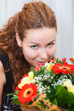 Happy smiling young woman with flowers Royalty Free Stock Photo