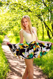 Happy smiling young woman in green summer forest Royalty Free Stock Photo