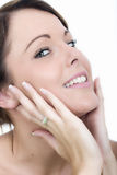 Happy Smiling Young Woman Hands on Face Looking Up Stock Photo