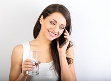 Happy smiling young woman with healthy skin talking on mobile ph royalty free stock images