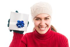 Happy smiling young woman holding a Christmas present stock photo