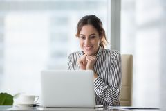 Free Happy Smiling Young Woman Looking At Laptop Screen. Stock Photography - 130102132