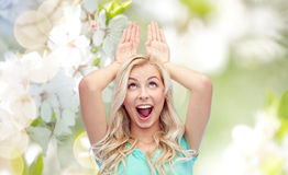 Happy smiling young woman making bunny ears Royalty Free Stock Photos