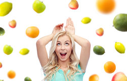 Happy smiling young woman making bunny ears Royalty Free Stock Photo
