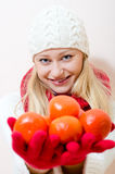Happy smiling young woman with mandarin citrus Royalty Free Stock Photography