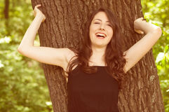Happy smiling young woman outdoor Stock Images
