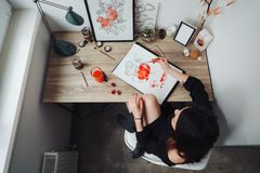 Young woman painting with watercolor paints stock image