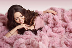 Happy smiling young woman in pink dress. Pendant Jewelry. Beauty Royalty Free Stock Images