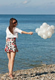 Happy smiling young woman playing with balloons Stock Images