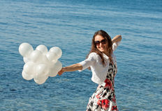 Happy smiling young woman playing with balloons Royalty Free Stock Photos