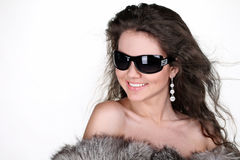 Happy smiling young woman present sun glasses Royalty Free Stock Image