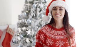 Happy smiling young woman in a Santa hat
