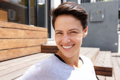 Happy smiling young woman with short hair stock images
