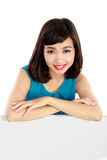 Smiling young woman showing blank signboard Stock Image