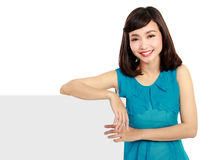 Happy smiling young woman showing blank signboard Royalty Free Stock Image