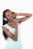 Happy smiling young woman singing Stock Image