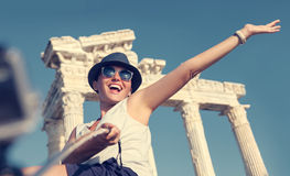 Happy smiling young woman take a selfie photo on antique sights Royalty Free Stock Image