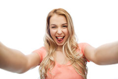 Happy smiling young woman taking selfie Stock Photo