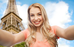 Happy smiling young woman taking selfie royalty free stock photography