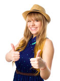 Happy smiling young woman with thumbs up gesture Royalty Free Stock Photo