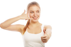 Happy smiling young woman with thumbs up gesture Stock Image