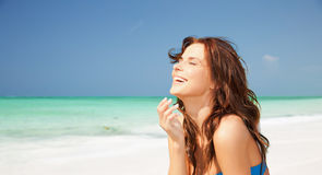 Happy smiling young woman on tropical beach Stock Images