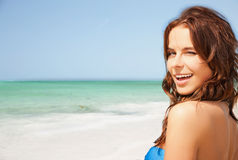 Happy smiling young woman on tropical beach Stock Photo