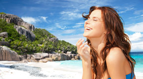 Happy smiling young woman on tropical beach Stock Photography