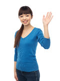 Happy smiling young woman waving hand over white. People, race, ethnicity and gesture concept - happy smiling young asian woman waving hand over white Royalty Free Stock Photos