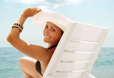 Happy smiling young woman in white hat Stock Photo