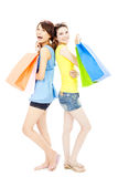 Happy and smiling  young women with shopping bags Royalty Free Stock Photo