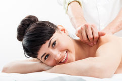 Happy smilling female getting a massage Royalty Free Stock Photo