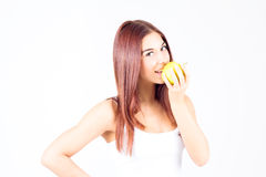 Happy smilling woman bites apple. Healthy lifestyle. Stock Image
