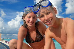 Happy snorkel teens at beach. Happy snorkel children on vacation at the beach Stock Photos