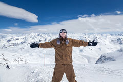 Happy snowboarder in high mountains Royalty Free Stock Image