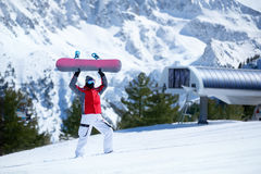 Happy snowboarder with snowboard Stock Photography