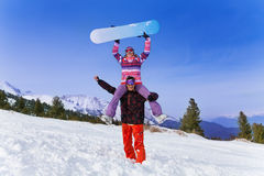 Happy snowboarder with woman on his shoulders Stock Photography