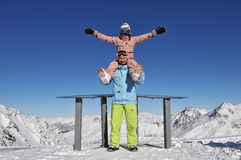 Happy snowboarders in ski resort. Beautiful young couple at the ski resort royalty free stock photos
