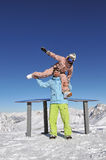 Happy snowboarders in ski resort. Beautiful young couple at the ski resort stock photos